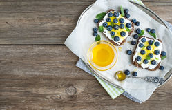 Healthy breakfast set with ricotta, fresh blueberries and honey Royalty Free Stock Photography