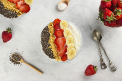 Healthy breakfast of smoothie with chia, coco, strawberry, nuts Royalty Free Stock Photography