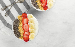 Healthy breakfast of smoothie with chia, coco, strawberry, nuts Stock Photo
