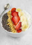Healthy breakfast of smoothie with chia, coco, strawberry, nuts Stock Photos