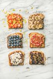 Vegan toasts with fruit, seeds, nuts and peanut butter Royalty Free Stock Image