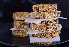 Healthy breakfast snack granola bars. Baked with oats,muesli,chia seeds,almonds,cashews,maple syrup,walnuts Royalty Free Stock Photo