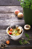 Healthy breakfast snack. Marble bowl with mango smoothie topping  cherry, nectarine, pollen,  fresh mint. Stock Photos