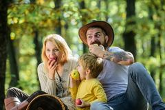 Healthy breakfast. Spring mood. Happy family day. Mother, cowboy father love their little boy child. Family picnic. Sunny weather. Healthy food. Happy son with royalty free stock image