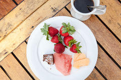 Healthy breakfast with strawberries watermelon coffee Royalty Free Stock Photos