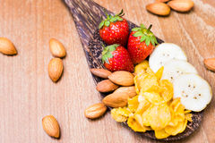 Healthy breakfast strawberry almond bananas and conflex. On wood spoon Stock Photography