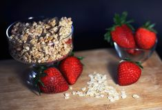 Healthy breakfast with strawberry, cereals and oats royalty free stock photos