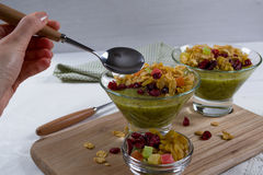 Healthy breakfast, summer dessert with smoothie kiwi, corn flakes and dried fruits Stock Image