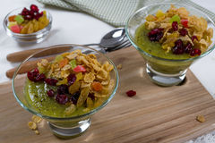 Healthy breakfast, summer dessert with smoothie kiwi, corn flakes and dried fruits Stock Photography