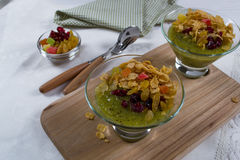 Healthy breakfast, summer dessert with smoothie kiwi, corn flakes and dried fruits Stock Images