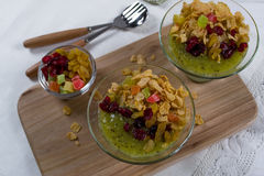 Healthy breakfast, summer dessert with smoothie kiwi, corn flakes and dried fruits Royalty Free Stock Photo