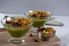 Healthy breakfast, summer dessert with smoothie kiwi, corn flakes and dried fruits in a glassware Stock Image