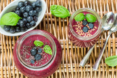 Healthy Breakfast. Summer dessert. Smoothies of blueberries with Chia seeds and flax seed and fresh juicy berries Royalty Free Stock Images
