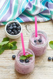 Healthy Breakfast. Summer dessert. Smoothies with homemade yoghurt, blueberries and Chia seeds. Selective focus stock photography