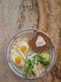 Healthy Breakfast. Breakfast, sunny side up egg in plate, one bread, lettuce Sala on plate Royalty Free Stock Photo