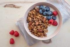 Healthy breakfast super food cereal concept with fresh fruit, granola, yoghurt. In a bowl royalty free stock images