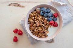 Healthy breakfast super food cereal concept with fresh fruit, granola, yoghurt. In a bowl stock photo