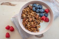 Healthy breakfast super food cereal concept with fresh fruit, granola, yoghurt. In a bowl stock images