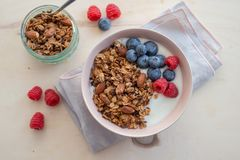 Healthy breakfast super food cereal concept with fresh fruit, granola, yoghurt. In a bowl royalty free stock image