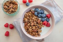 Healthy breakfast super food cereal concept with fresh fruit, granola, yoghurt. In a bowl royalty free stock photo