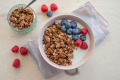 Healthy breakfast super food cereal concept with fresh fruit, granola, yoghurt. In a bowl stock photos