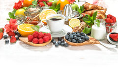 Healthy breakfast table with coffee, croissants, muesli, fresh b Stock Images