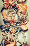 Healthy breakfast table with various cereals muesli, oat flakes ,seeds, nuts and berries Royalty Free Stock Photo