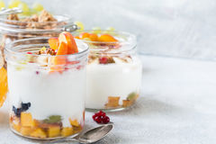 Healthy breakfast table: yogurt, fruits, honey, muesli and granola Royalty Free Stock Images