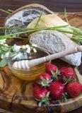 Healthy breakfast-Tasty organic rolls and bread wi Stock Photos