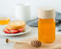 Healthy breakfast with toast, honey and strawberry Stock Images