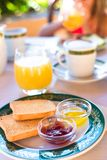 Healthy breakfast with toast, jam and juice on the Stock Image