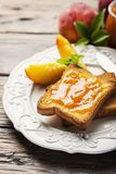 Healthy breakfast with toast and peach jam. Healthy summer breakfast with toast and peach jam, selective focus image and rustic style stock photos