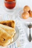 Healthy breakfast: toast, tea and eggs Stock Photos