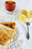 Healthy breakfast: toast, tea and lemon Stock Image