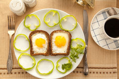 Healthy breakfast with toasted bread and eggs with cup of tea and milk. Royalty Free Stock Photo