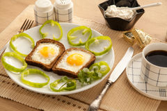 Healthy breakfast with toasted bread and eggs with cup of tea and milk. Royalty Free Stock Images