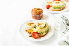 Healthy breakfast: toasts with avocado slices, tomato, paprika and eggs Royalty Free Stock Photography