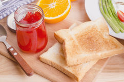 Healthy breakfast with toasts and strawberry jam, on table Royalty Free Stock Photography