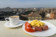 Healthy breakfast with tomato, sausage, scramble eggs and coffee.  Stock Images
