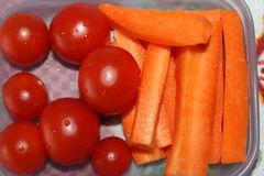 Healthy breakfast tomatoes and carrots Stock Images