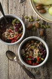 Healthy breakfast.Two bowls of muesli with oats, nuts and dried fruits - apples, resins, pumpkin seeds and almonds on wooden table royalty free stock photography