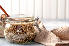 Healthy breakfast, vegan vegetarian granola made of green buckwheat with nuts and pumpkin seed royalty free stock photo