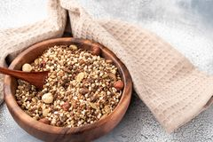 Healthy breakfast, vegan vegetarian granola made of green buckwheat with nuts and pumpkin seed stock photography