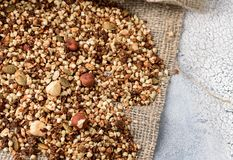 Healthy breakfast, vegan vegetarian granola made of green buckwheat with nuts and pumpkin seeds stock image