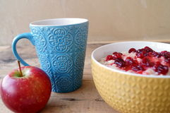 Healthy breakfast, vegetarian. Oatmeal with cranberries, apple, tea. stock photo