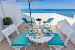 Healthy breakfast on veranda with sea views. Royalty Free Stock Photography