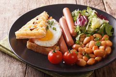 Healthy breakfast: waffle sandwich with egg, sausages, beans and Stock Image