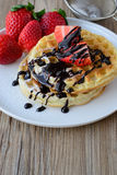 Healthy breakfast waffle with strawberry  and maple syrup on top Stock Images