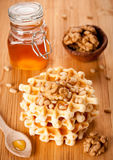Healthy breakfast: waffles, nuts and honey Royalty Free Stock Images