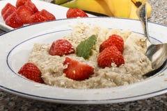 Healthy breakfast with porridge and strawberry stock photos